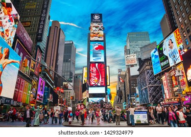 """NEW YORK CITY - MAY 11: Times Square with tourists on May 11, 2013. Iconified as """"The Crossroads of the World"""" it's the brightly illuminated hub of the Broadway Theater District.953"""