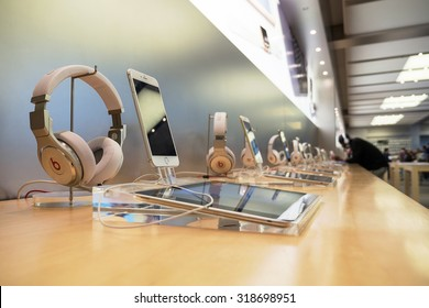 NEW YORK CITY - MAY 13, 2015: Ipad, Iphone and earphones dispayed inside Apple store. As of 2014, Apple employs 72,800 permanent full-time employees, maintains 437 retail stores in fifteen countries.