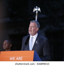 NEW YORK CITY - MAY 13 2016:  Andrew Cuomo & Bill de Blasio appeared in front of the Stonewall Inn for a vigil on behalf of the victims of the Orlando Pulse massacre. Mayor de Blasio speaks