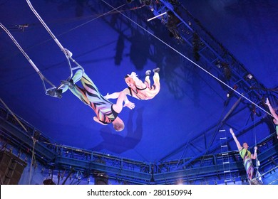 """NEW YORK CITY - MAY 17 2015: Big Apple Circus closed out its season in Cunningham Park, Queens, with a show called """"Metamorphosis"""". Members of the Anaskin Troupe"""