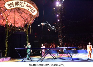 """NEW YORK CITY - MAY 17 2015: Big Apple Circus closed its 2015 season with a show in Cunningham Park, Queens, entitled """"Metamorphosis"""" Trampoline work"""