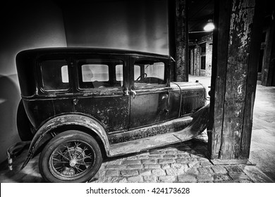 NEW YORK CITY MAY 18 2016: Unrestored Ford Model A in plain white-washed shelter, view of front, grill