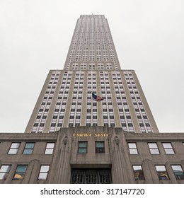 NEW YORK CITY - MAY 19, 2015: The Empire State Building view from the ground on 5th Avenue.