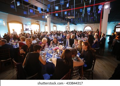 NEW YORK CITY - May 19 2016: Officials of the Brooklyn Kindergarten Society, one of the nation's oldest early education societies, hosted its annual gala in Red Hook. Dinner in Liberty Warehouse