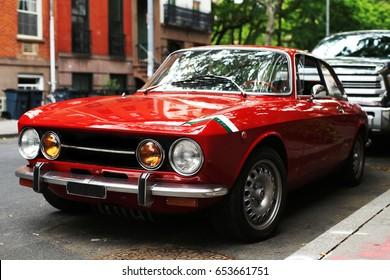 NEW YORK CITY - MAY 20 Retro red car Alfa Romeo gta on the street of New York City and America, May 20th, 2013 in Manhattan, New York City.
