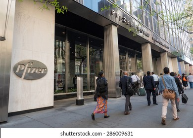 NEW YORK CITY - MAY 2015: People crossing in front of Pfizer building. Pfizer is an American multinational pharmaceutical corporation, one of the world's largest pharmaceutical companies.