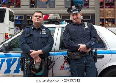 NEW YORK CITY - MAY 2015: NYPD Police Officers at Times Square. The New York City Police Department, established in 1845, is the largest municipal police force in the United States.