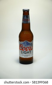 New York City - May 2016: Coors Light beer bottle against white background. Product shot. Silver Bullet alcoholic drink branded cold as rocky mountains in Colorado. Brewed in USA