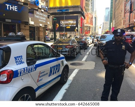 81cf3ab2ca8a2 New York City - May 2017  Times Square car accident kills and injures  pedestrians breaking news scene in Manhattan. NYPD police officer stands  guard of ...