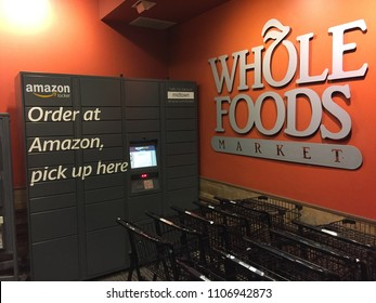 NEW YORK CITY - MAY 2018: Whole Foods Market (WFM). Amazon (NASDAQ: AMZN) Locker is self-service parcel delivery service. Customers select Locker location as delivery address, retrieve location