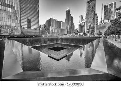 NEW YORK CITY - MAY 21: 9/11 Memorial geometric architecture and buildings, May 21, 2013 in New York City. The Memorial honors people killed in the terror attacks of September 11, 2001