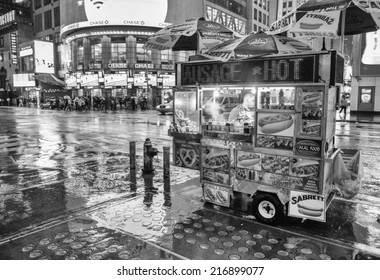 NEW YORK CITY - MAY 21: A hot dog stand vendor stays open late into the night to sell a few more hot dogs to late night tourists, May 21, 2013 in NYC.