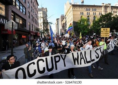 NEW YORK CITY - MAY 2102: Occupy Wall streeters march down Broadway toward lower Manhattan.