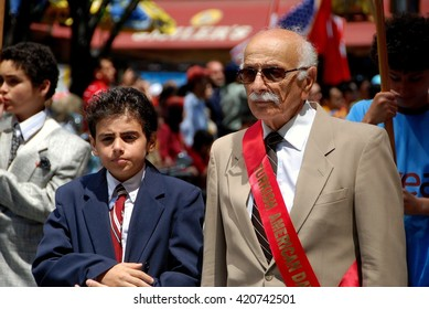 New York City - May 22, 2009:   Elderly gentleman marching with his grandson in the annual Turkish Day Parade on Madison Avenue
