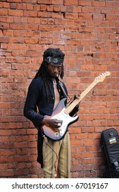 NEW YORK CITY - MAY 22: A busker performs Jimi Hendrix songs and dressed as Hendrix May 22, 2010 in New York, New York.