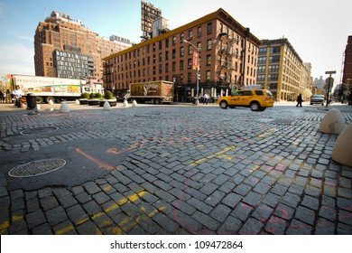 NEW YORK CITY - MAY 23: Cobblestone intersection in historic New York City meatpacking district on May 23, 2012.  This trendy neighborhood was once a predominate meat distribution center.