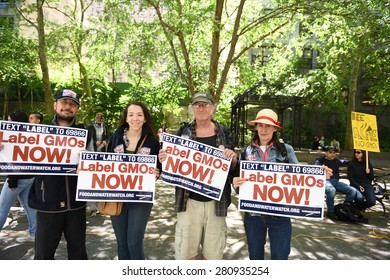 NEW YORK CITY - MAY 23 2015: environmental activists joined a global day out against Monsanto's GMO programs & demanding that foods be labeled.