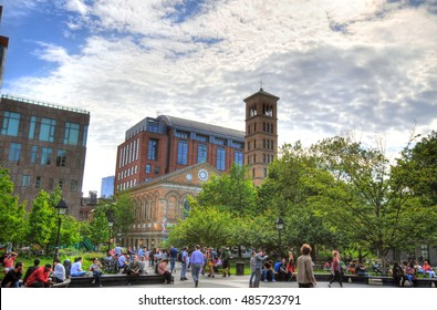 NEW YORK CITY, MAY 23: Colorful HDR image of people outside the New York University (NYU) in Washington Park in Greenwich Village on cloudy sky NYC, May 23, 2016