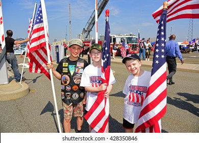 NEW YORK CITY - MAY 25 2016: Ships of the US Navy docked in the Brooklyn Ferry Terminal as the 28th annual Fleet Week started. Members of Little Patriots greet returning service members