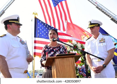 NEW YORK CITY - MAY 25 2016: Ships of the US Navy docked in the Brooklyn Ferry Terminal as the 28th annual Fleet Week started. Borough deputy president Diana Reyna speaks