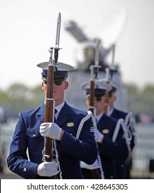 NEW YORK CITY - MAY 25 2016: Ships of the US Navy docked in the Brooklyn Ferry Terminal as the 28th annual Fleet Week started. US Coast Guard synchronized rifle team displays skills
