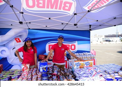NEW YORK CITY - MAY 25 2016: Ships of the US Navy docked in the Brooklyn Ferry Terminal as the 28th annual Fleet Week started. Offering samples of Bimbo products
