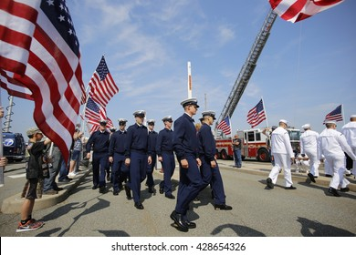 NEW YORK CITY - MAY 25 2016: Ships of the US Navy docked in the Brooklyn Ferry Terminal as the 28th annual Fleet Week started. Crews march past US flags for liberty