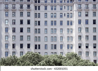 NEW YORK CITY - MAY 28 2016: Closeup of The Plaza hotel with endless rows of windows and trees below
