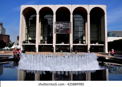 New York City - May 30, 2010:  The Metropolitan Opera House and Josie Robertson Plaza's fountain at Lincoln Center for the Performing Arts
