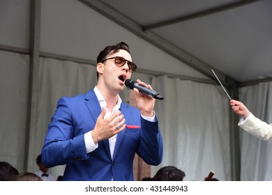 """NEW YORK CITY - MAY 30 2016: Green-Wood Cemetery staged it's 28th annual Memorial Day concert by the Symphonic Orchestra at 3rd Street. Broadway star Ryan Silverman sings """"Maria"""""""