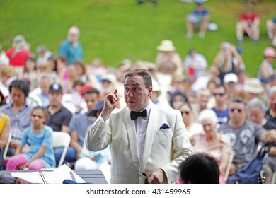 NEW YORK CITY - MAY 30 2016: Green-Wood Cemetery staged it's 28th annual Memorial Day concert by the Symphonic Orchestra at 3rd Street. Conductor Brian Worsdale