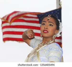 NEW YORK CITY - MAY 31 2019: the 31st annual Phagwah Parade filled the streets of Richmond Hill, Queens with color & festivity. Urvashie Kissoon dances Kathak style