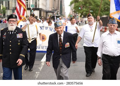 NEW YORK CITY - MAY 31 2015: the 51st annual Israel Day parade & festival filled Fifth Avenue from 57th to 74th Streets with thousands of marchers. Retired chaplain Jacob Goldstein marches with vet