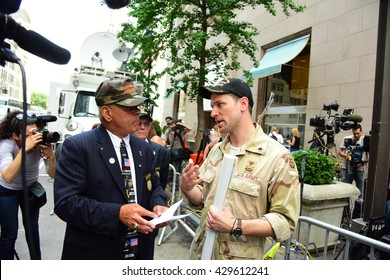 NEW YORK CITY - MAY 31 2016: Pro & anti Trump activists gathered outside Trump Towers to debate candidate's support for veterans. Trump supporter Al Baldasaro (lt) speaks with opponent Perry O'Brien