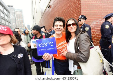 NEW YORK CITY - MAY 4 2017: Hundreds of activists rallied & marched on West Side Hwy to oppose President Trump's visit to the USS Intrepid. A smaller group of Trump supporters counter-protested.