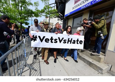NEW YORK CITY - MAY 4 2017: Hundreds of activists rallied & marched on West Side Hwy to oppose President Trump's visit to the USS Intrepid.