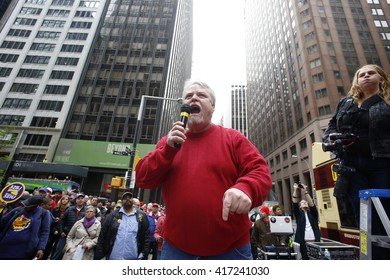 NEW YORK CITY - MAY 5 2016: Striking Verizon workers gathered with members of other unions & labor leaders in front of Verizon's Wall St headquarters. CWA local 1101 president Keith Purce