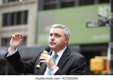 NEW YORK CITY - MAY 5 2016: Striking Verizon workers gathered with members of other unions & labor leaders in front of Verizon's Wall St headquarters. Mario Cilento, president NY AFL-CIO