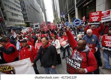 NEW YORK CITY - MAY 5 2016: Striking Verizon workers gathered with members of other unions & labor leaders in front of Verizon's Wall St headquarters