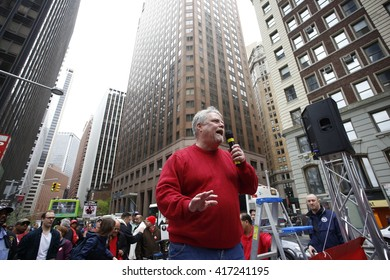NEW YORK CITY - MAY 5 2016: Striking Verizon workers gathered with members of other unions & labor leaders in front of Verizon's Wall St headquarters. Keith Purce, CWA local 1101 president