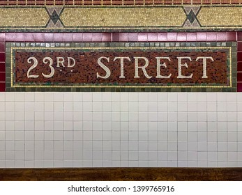 New York City - May 8, 2019: Mosaic tile sign at the 23rd Street Subway Station in New York City.