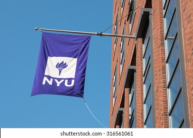 NEW YORK CITY - MAY 8, 2015: NYU flag on historic Building in Manhattan. New York University is the largest private institution in the United States.