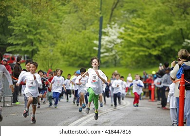 NEW YORK CITY - MAY 8 2016: the 10th annual Japan Day festival took place in Central Park starting with a NYRR sponsored Kids' Run. Kids approach finish line