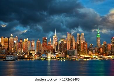 New York City Midtown Manhattan skyline at dusk over Hudson River