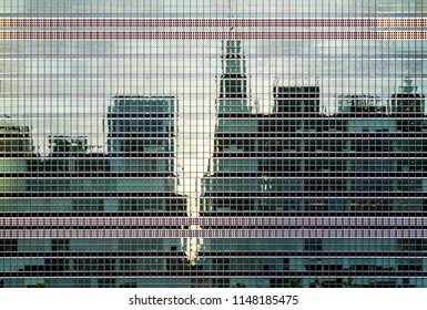 New York City midtown skyline reflected in the glass windows of the UN building in Manhattan