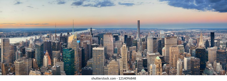 New York City midtown skyline with skyscrapers and urban cityscape panorama at sunset.