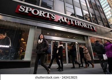 NEW YORK CITY - MONDAY, DEC. 29, 2014: Pedestrians walk past a Sports Authority retail outlet. Sports Authority, Inc. is one of the largest sporting goods retailers in the United States.