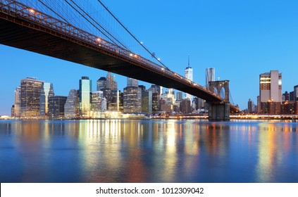 New York City at night with Brooklyn bridge