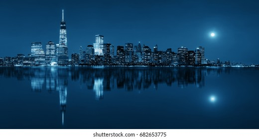New York City at night with urban architectures reflections