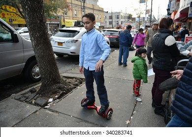 NEW YORK CITY - NOV 12: A child rides a hoverboard on a street in a Brooklyn Chinatown on Nov 12, 2015 in New York City, USA. NYPD has since declared hoverboards or rideables are illegal in NYC.